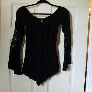 Small black romper longsleeved with cutout